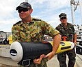 US Navy 080723-N-9698C-130 Aerographer's Mate Ryan Thuecks, assigned to the Naval Oceanography Mine Warfare Center and Australian Navy 1st Class Sean Huron carry a Remote Environmental Measuring Unit (REMUS) during the Honolulu.jpg