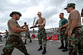 US Navy 090205-N-0783S-001 Chief Master-at-Arms Kurtis Chapman instructs members of the Panamanian Air and Maritime Service on self-defense techniques during a Southern Partnership Station armed sentry class.jpg