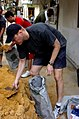 US Navy 090314-M-9292S-002 U.S. Navy Commander Lawrence R. Kuhn fills sand bags during the reconstruction of the Korat Christian Church as a part of the humanitarian efforts of Exercise Cope Tiger.jpg