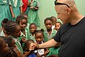 US Navy 090508-A-1786S-002 Navy Chaplain David Oravec shakes hands with an Antiguan child at a local school during a Continuing Promise 2009 community service project.jpg