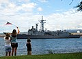 US Navy 090615-N-8539M-090 Family members of Sailors assigned to the Oliver Hazard Perry-class guided-missile frigate USS Crommelin (FFG 37) watch as the ship departs Pearl Harbor.jpg