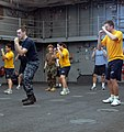 US Navy 090716-A-7779L-358 Sailors aboard USS Oak Hill (LSD 51) stand in the defensive position during the defensive tactics training. Oak Hill is participating in a combined multinational exercise Southern Partnership Station.jpg