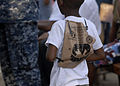 US Navy 100207-N-2000D-001 A Haitian boy uses a meal-ready-to-eat bag as a backpack in Neply, Haiti.jpg