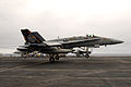 US Navy 100216-N-3327M-192 An F-A-18C Hornet assigned to the Warhawks of Strike Fighter Squadron (VFA) 97 lands aboard the aircraft carrier USS Nimitz (CVN 68).jpg
