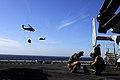 US Navy 100222-N-2735T-120 Aircrewmen gather tools aboard USS Nassau (LHA 4) after performing routine maintenance on an MV-22B Osprey.jpg
