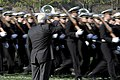 US Navy 100407-D-7203C-008 Secretary of Defense Robert M. Gates salutes as Midshipmen pass-in-review during a parade in his honor at the U.S. Naval Academy in Annapolis, Md.jpg