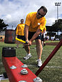 US Navy 100519-N-7498L-162 Cryptologic Technician (Maintenance) 1st Class Stephen Huber swings a sledgehammer at the high striker during a Morale, Welfare and Recreation Fitness and Wellness Fair.jpg