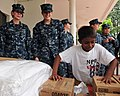 US Navy 110906-N-TO930-039 A Malaysian child at the Rumah Juara children's home plays with toys and supplies brought by Sailors from the John C. S.jpg