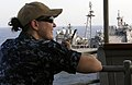 US Navy 111004-N-GH121-043 Lt. j.g. Martha Rowe, officer of the deck, observes the ship's progress from the bridge wing of the amphibious dock lan.jpg