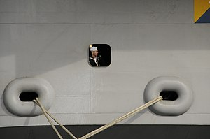 US Navy 111210-N-QO773-127 A Sailor observes other Sailors securing mooring lines.jpg