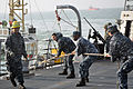 US Navy 111227-N-ZZ999-001 Sailors heave a line aboard USS Chafee.jpg