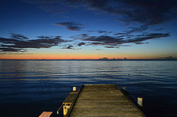 Twilight evening view into the sea (Mona Passage) and the horizing from the shore at Joyuda, Puerto Rico,