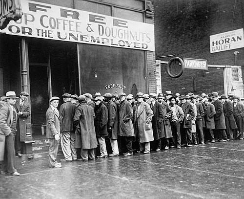 Unemployed men outside a soup kitchen in Depression-era Chicago, Illinois, the US, 1931 Unemployed men queued outside a depression soup kitchen opened in Chicago by Al Capone, 02-1931 - NARA - 541927.jpg