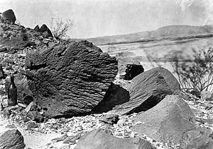 Aeolian processes - Rock carved by drifting sand below Fortification Rock in Arizona (Photo by Timothy H. O'Sullivan, USGS, 1871)