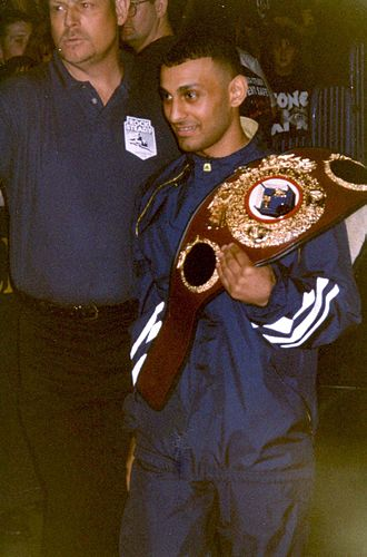Naseem Hamed - Hamed with the WBO featherweight title at a WWF event, 1997