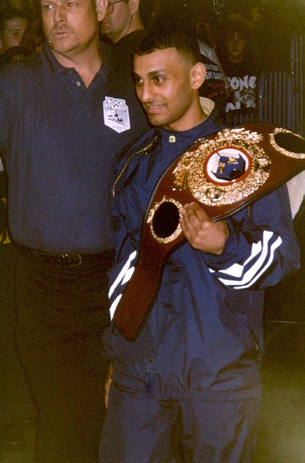 Hamed with the WBO featherweight title at a WWF event, 1997 WWE - Sheffield 020499 (47).jpg