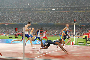 United States at the 2008 Summer Olympics - American David Neville dives for the bronze medal as Jeremy Wariner takes second place behind LaShawn Merritt, completing a sweep of the 400 m final.