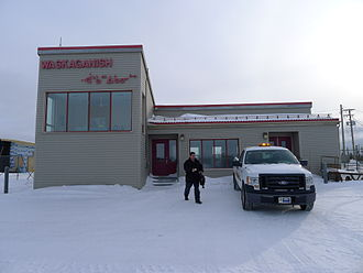 Waskaganish Airport - The old airport's main building in front of the airstrip, January 2011