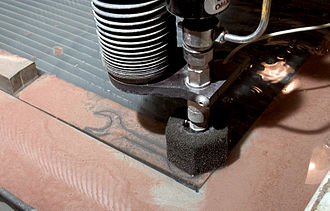 Water jet cutter - A water jet cutting a metal tool