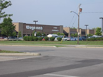 "Wegmans - Exterior of a typical Wegmans, in the style common in the late 1990s; in Amherst, New York at the ""Alberta Drive"" location."