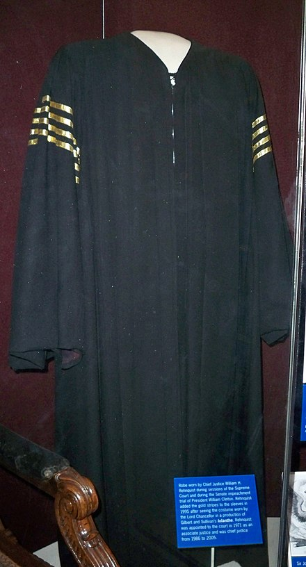 Robes worn by Rehnquist while he presided over the impeachment trial of President Clinton, showing the four yellow stripes he added. William Rehnquist's robe by Matthew Bisanz.JPG