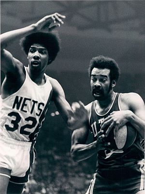 Willie Wise - Wise being guarded by New York Nets player Julius Erving.