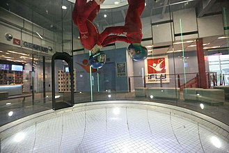 Vertical wind tunnel - Two instructors practice flying inside an indoor wind tunnel