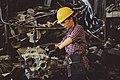 Woman mechanic working on engine.jpeg
