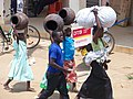 Woman with the girls sets out to look for market for pots in Arua town. PHOTO BY FELIX WAROM OKELLO.jpg