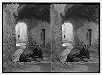 Women of Bethlehem grinding in courtyard before their home. LOC matpc.04156.jpg