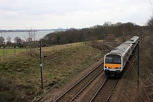 Mayflower line - A Class 321 train passes the River Stour near Wrabness