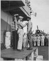 """Capt. H. W. Taylor making award presentations aboard U.S.S. Cowpens (CVL 25). Fred Magee, Jr., St3-c USN, receiving com - NARA - 520664.tif"