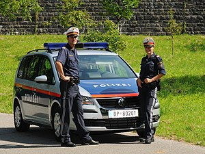 Law enforcement by country - Austrian police officers standing next to their Volkswagen Touran