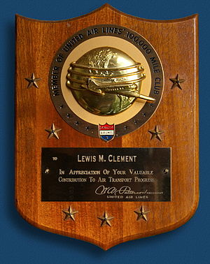 """History of United Airlines - Early 1950s """"100,000 Mile Club"""" Award plaque (stars represent additional awards)"""