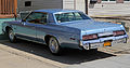 1977 Plymouth Gran Fury Brougham 2d HT, rear left.jpg