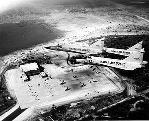 199th Fighter Squadron - The Hawaii Air National Guard F-102 'Deuces' fly over the new 154th Wing complex. The 154th Wing hangar complex was dedicated February 17, 1962, during the Hawaii Air National Guard's 15th anniversary luau.