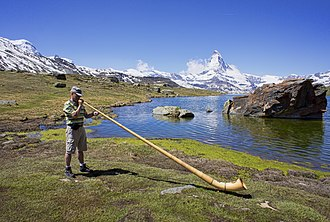 Horn (instrument) - Alphorn player near Zermatt