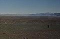 1 man in a longely landscape. Mountain bare after cedars gone. (37755928001).jpg