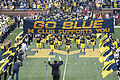 20090926 Michigan Wolverines football team enters the field with marching band salute.jpg