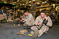 20151025-UK-USMC cleaning weapons o-b HMS OCEAN, Trident Juncture 15 (22307699138).jpg