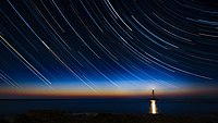 2017-04 Circumpolar trails sunset at La Hague lighthouse.jpg