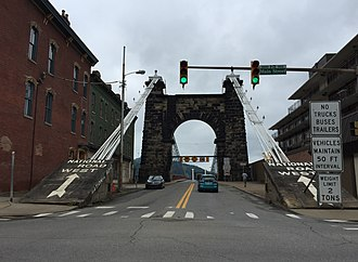 Wheeling Suspension Bridge - View west from the east end of the bridge in downtown Wheeling. Note the multiple warning signs restricting access.