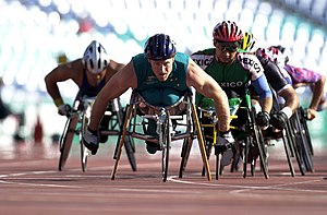 Australia at the 2000 Summer Paralympics - 211000 - Athletics wheelchair racing 10km heat John Maclean action 2 - 3b - 2000 Sydney race photo