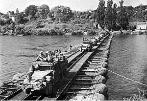 291st Engineer Combat Battalion (United States) - A US military treadway bridge assembled with support from pneumatic pontoons.