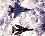 4477th Test and Evaluation Squadron MiG-23MS with Nellis F-15.jpg