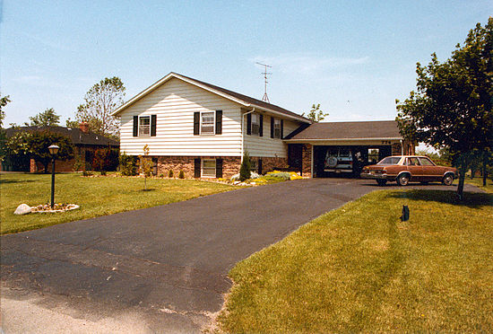 A typical suburban front yard in mid-1980s Greenwood, Indiana, United States.