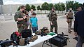A DSS federal agent talks to spectators about the gear and arsenal displayed during a demonstration at the National Museum of the Marine Corps in Triangle, Virginia, June 29, 2016. (33106138498).jpg