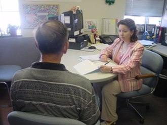 Probation officer - A probation and parole officer with the Missouri Department of Corrections interviews a drug-related offense probationer.