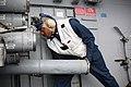 A Sailor loads a chaff round at sea. (8426061991).jpg