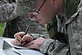 A U.S. Soldier with Alpha Troop, 1st Squadron, 38th Cavalry Regiment, 525th Battlefield Surveillance Brigade writes a report for simulated unexploded ordnance during a Kosovo Force (KFOR) mission rehearsal 130507-A-QC664-005.jpg